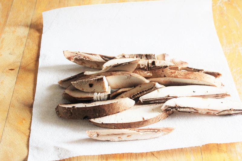 portobello mushrooms sliced for fries on paper towel