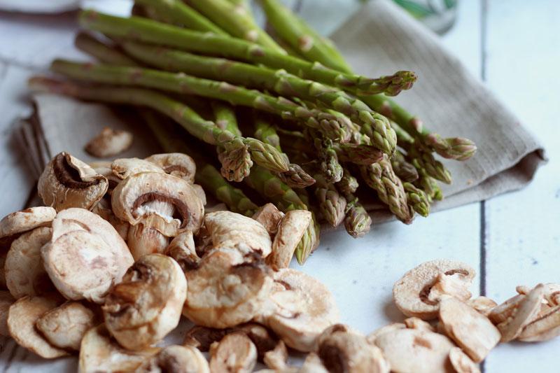 Fresh asparagus and fungi