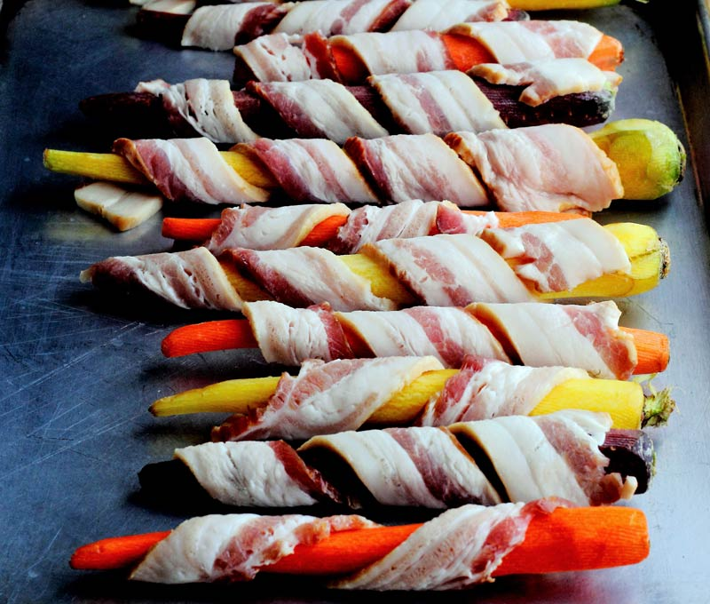 Honey maple glazed roasted carrots in bacon