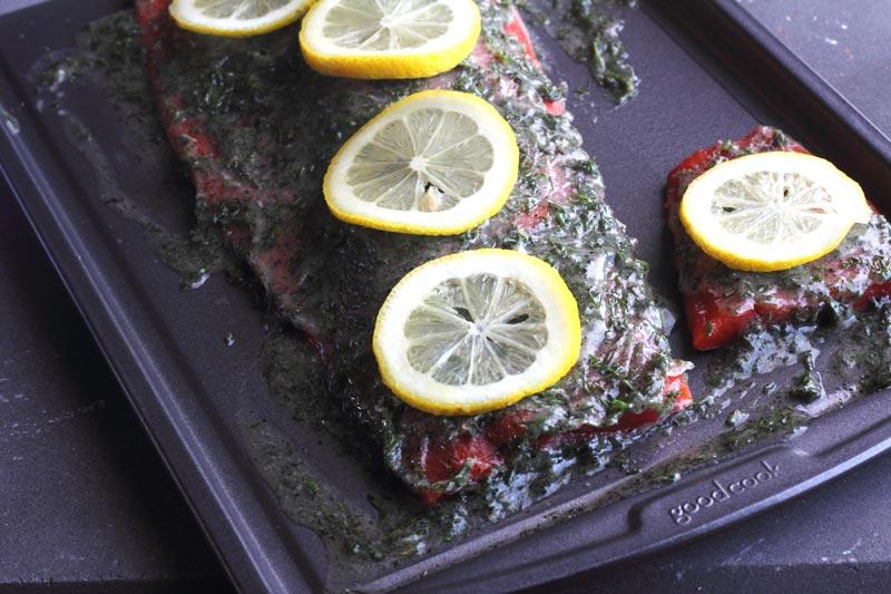 Herbed Sockeye Salmon on sheet pan with lemons