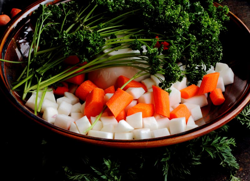 Size of carrots and turnips cut along with curly parsley