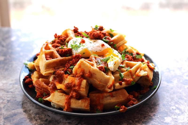 Fully loaded southwestern waffle poutine for national waffle day jalapeno cheddar chorizo egg parsley