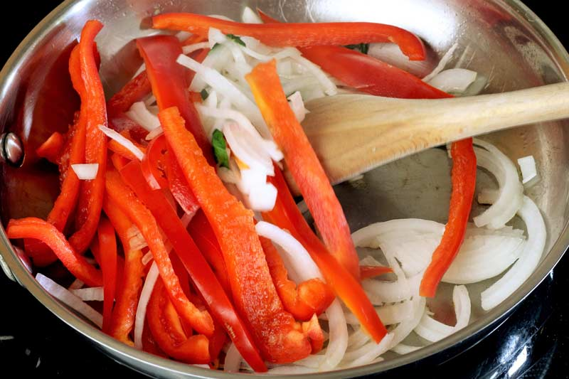 red pepper and onion in pan