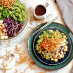 Chinese Chopped Chicken Salad on plate and in bowl with dressing