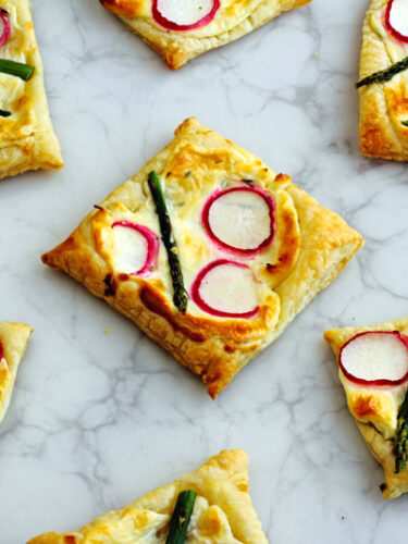 Lemon and Ginger infused cream cheese atop puff pastry and topped with Asparagus & Radish. My kids call them the healthy pop tarts, I call them party fab